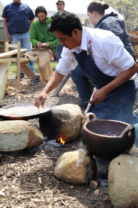 Neftali Duran cooking with his comal