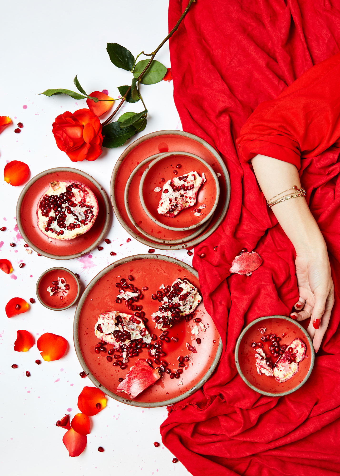 Red East Fork Pottery wares with strewn with pomegranate and more