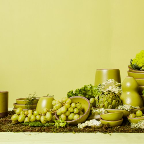 Spread of East Fork Pottery wares with various green fruits and vegetables