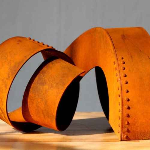 Orange metal coil sculpture
