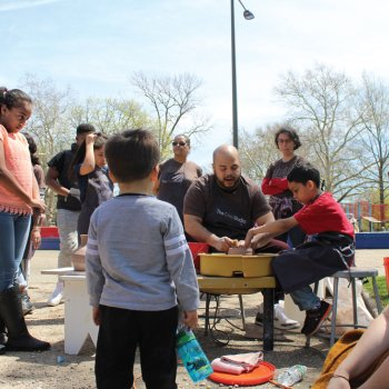 Roberto Lugo helps kids with pottery