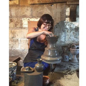 Christina Erives working pottery